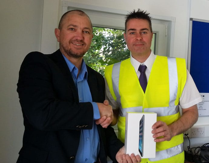 Brett Winstone presents Steve Fisk with the iPad mini
